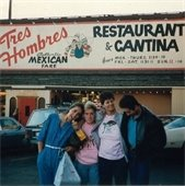 four people in front of Tres Hombres Restaurant