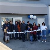 Group outside local business for ribbon cutting